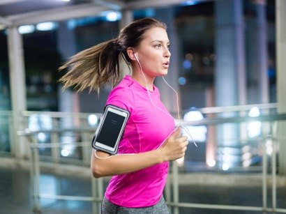 woman listening to music on her run