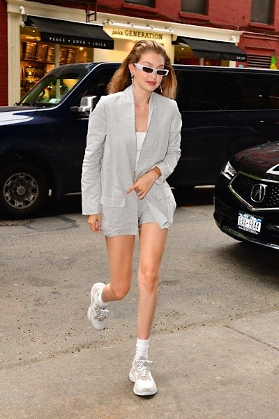 gigi hadid in a blazer and chunky trainers