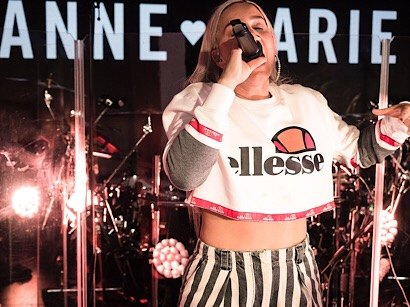 Anne Marie singing in Ellesse