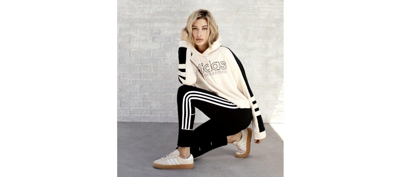 hailey baldwin crouched adidas