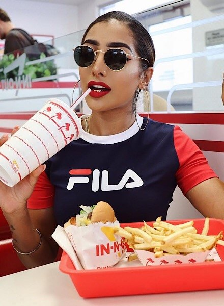influencer in cropped fila t-shirt