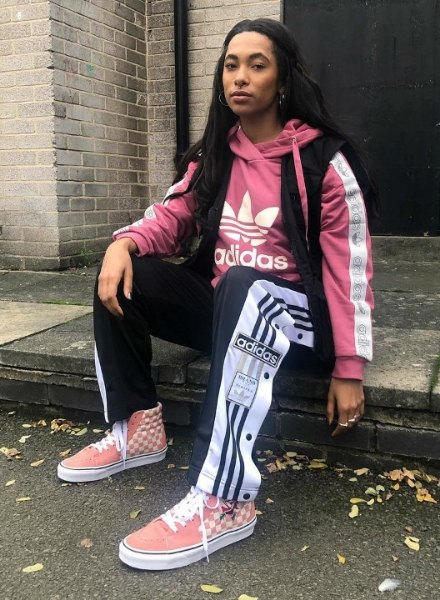 jessy law in pink hoodie and adidas popper pants